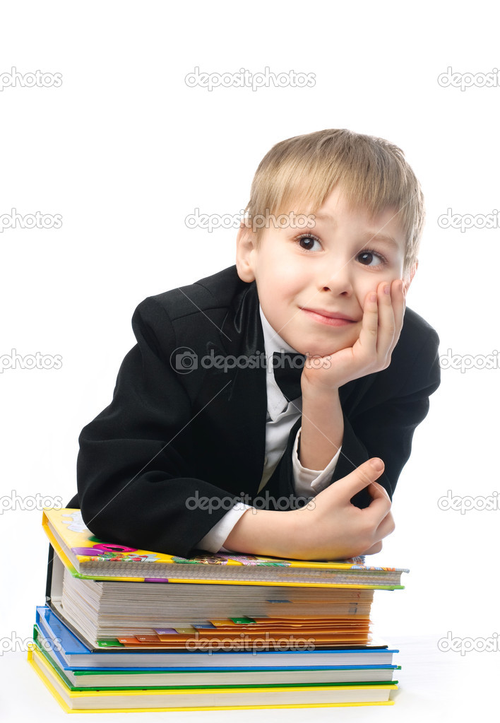 Bored schoolboy sitting by the table with a lot of books and unwilling to do homework — Stock Photo #1795995
