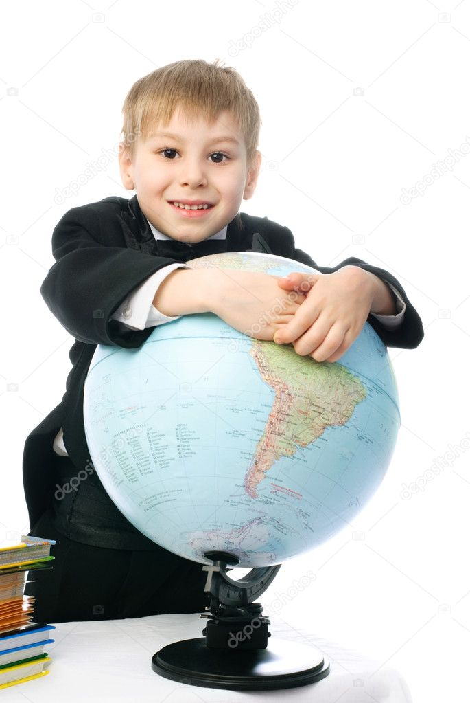 Happy little schoolboy smiling and embracing a big globe — Stock Photo #1796003