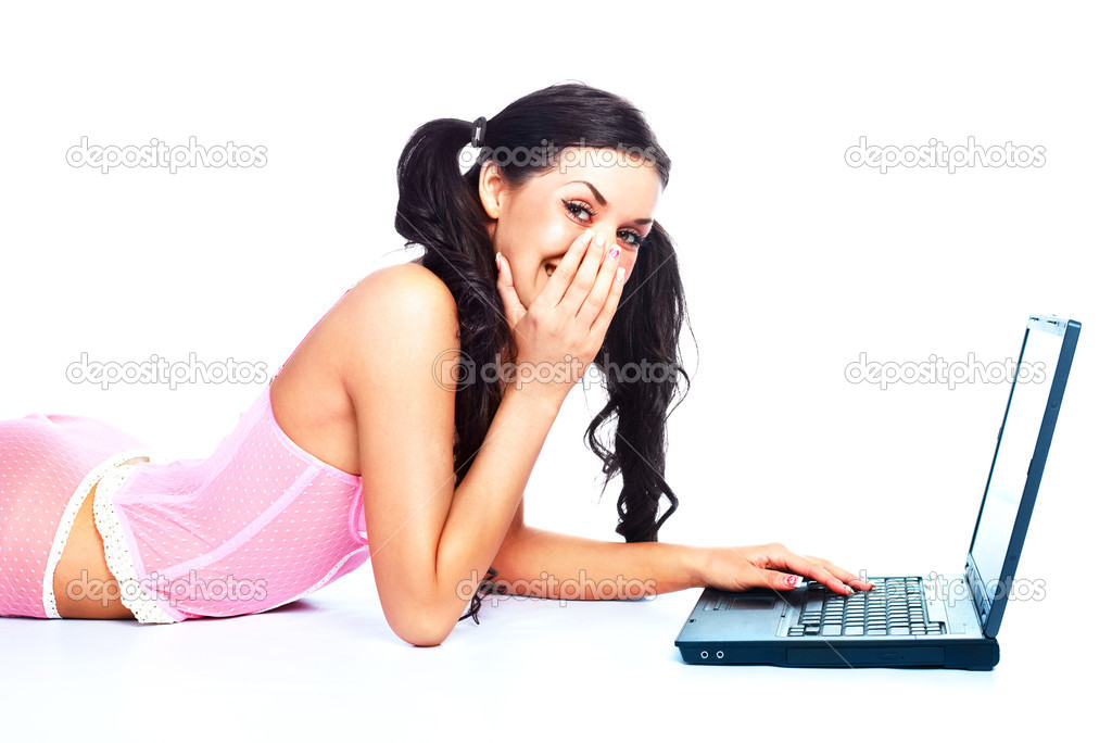 Portrait of a suprised brunette girl  on the floor with a laptop  Stock Photo #1796708