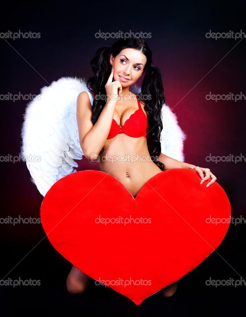 Sexy young woman with a big heart in her hands — Stock Photo #1796982