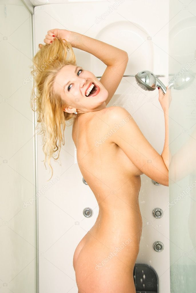 Portrait of a beautiful young happy woman taking a shower  Stock Photo #1798567