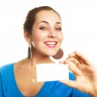 Woman showing a business card — Stock Photo #1801602