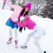 Royalty-Free Stock Photo: Two girls ice skating