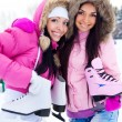Stock Photo: Two girls go ice skating