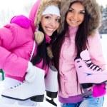 Two girls go ice skating — Stock Photo