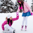 Stock Photo: Two girls ice skating