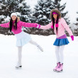 Two girls ice skating — Stock Photo #1809322