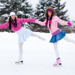 Two girls ice skating — Foto de Stock