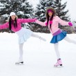 Two girls ice skating — Stock Photo #1809467