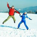 Happy jumping couple — Stock Photo