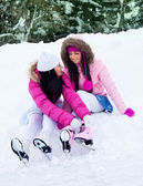 Girls going to ice skating — Stock Photo