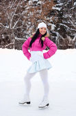 Girl ice skating — Stock Photo