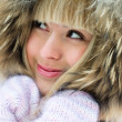 Beautiful girl in winter park - Stock Photo