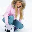 Woman putting on a snowboard — Stock Photo