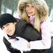 Couple having fun in winter park — Stock Photo