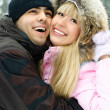 Couple in winter park — Stockfoto