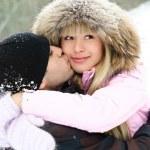 Happy couple in winter park — Stock Photo #1810321