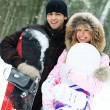 Happy couple with snowboards — Stock Photo