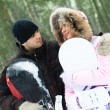 Young couple with snowboards — Stock Photo #1810388