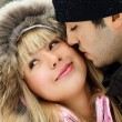 Young couple in winter park — Stock Photo #1810496