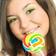 Pretty girl eating a candy — Stock Photo