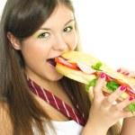 jolie fille manger un hot dog — Photo