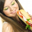 Pretty girl eating a sandwich — Stock Photo