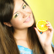 Girl with an orange — Stock Photo