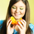 Girl with an orange - Stock Photo