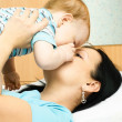 Mother and baby on the bed — Stock Photo #1813410