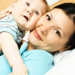 Mother and baby on the bed — Stock Photo #1813424