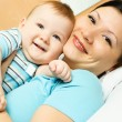 Stock Photo: Mother and baby on the bed