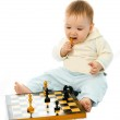 Cute baby playing chess — Stock Photo