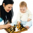 Mother and baby playing chess — Stock Photo