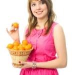 Beautiful girl with tangerines — Stock Photo