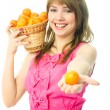 Woman with tangerines — Stock Photo