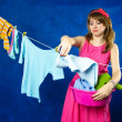 Foto Stock: Young housewife