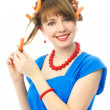 Woman putting on hair curlers - Stock Photo