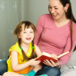 Mother and daughter reading a book — Stock Photo #1814642