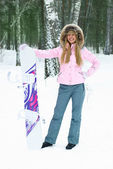 Young woman with a snowboard — Stock Photo