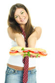 Girl giving us a sandwitch — Stock Photo