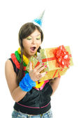 Girl opening her present — Stock Photo