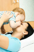 Mother and baby on the bed — Stock Photo