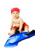 Cute baby with blue flippers — Stock Photo
