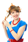 Woman putting on hair curlers — Stock Photo