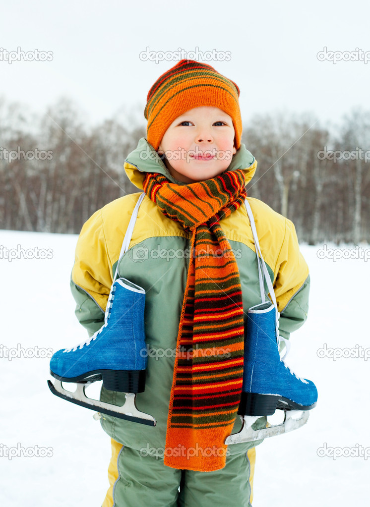 Cute little boy wearing warm winter clothes going ice skating  — Stock Photo #1811945