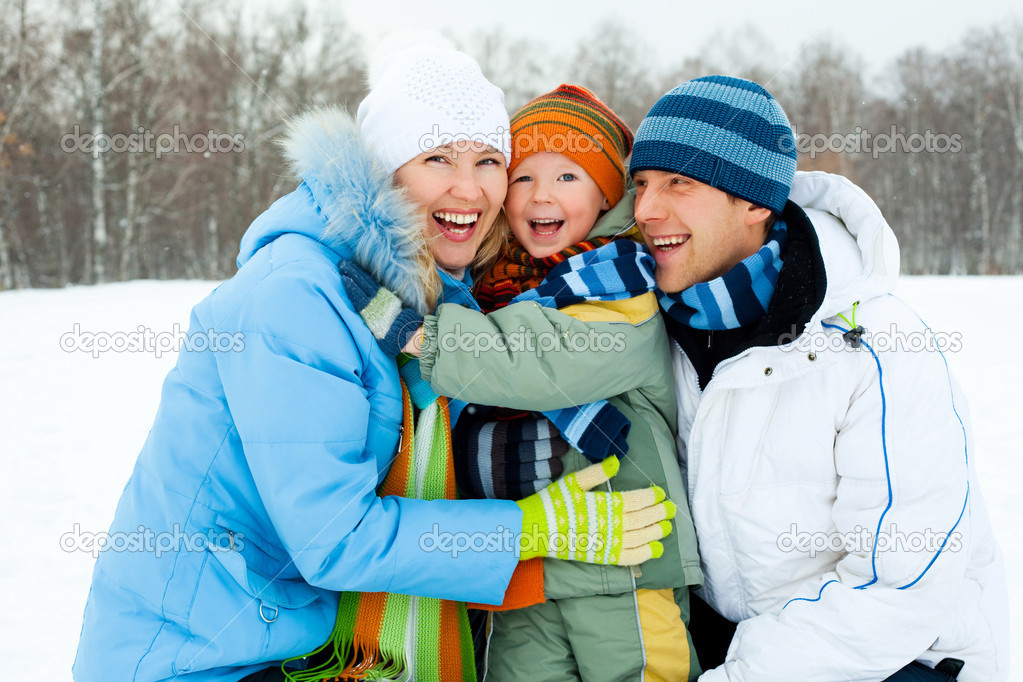 Happy young family spending time outdoor in winter — Stock Photo #1811979