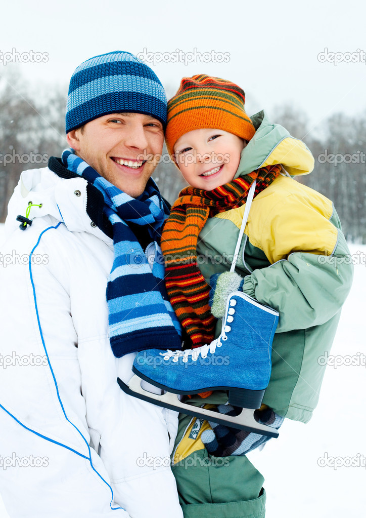 Happy family, young father going ice skating with his little son  Stock Photo #1812254