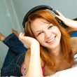 Girl listening to the music — Stock Photo