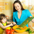 Mother and daughter cooking together — Stock Photo #1826590